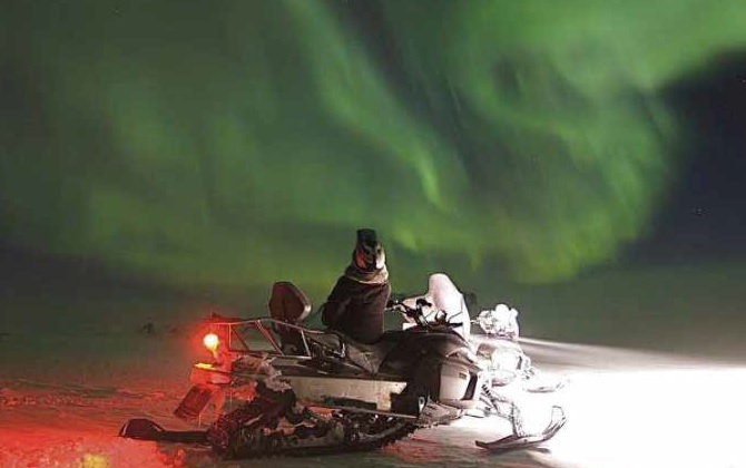 Northern Lights on Snowmobile